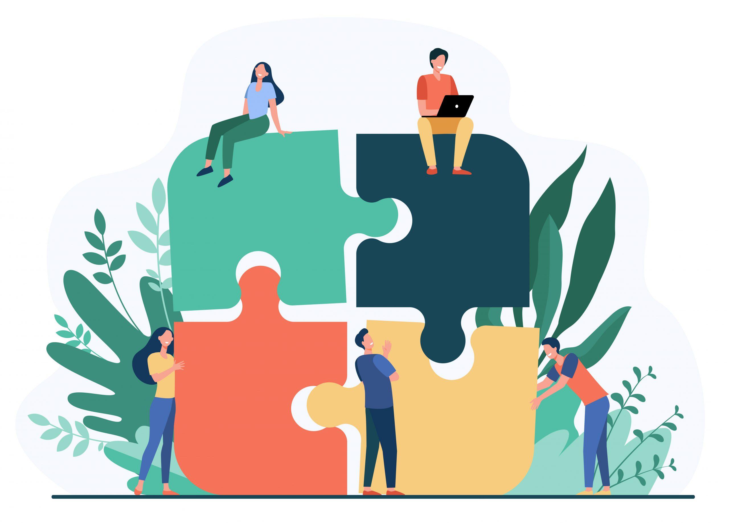 Équipe de travail assemblant un puzzle. Concept de travail d'équipe, de partenariat et de coopération.